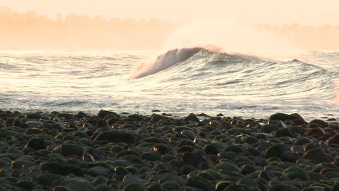 Pan of a wave breaking at Surfers Point in Ventura,... Stock Video Footage