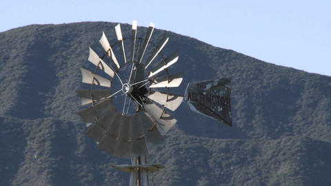 Spinning windmill drawing water from a well in Ojai, California Footage