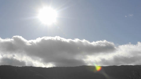 Time lapse of spring clouds passing over a ridge in Oak View, California Footage