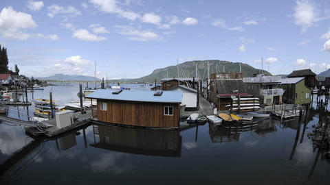 Time lapse of clouds passing over a dock and boats in Cowichan Bay on Vancouver Island in British Co Footage