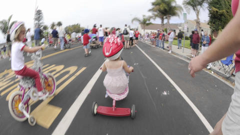 Point of view time lapse of a girl on a tricycle in the... Stock Video Footage