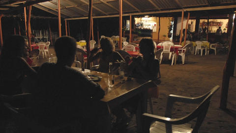 Time lapse of people dining outdoors at La Saladita Beach in Guerrero, Mexico Footage