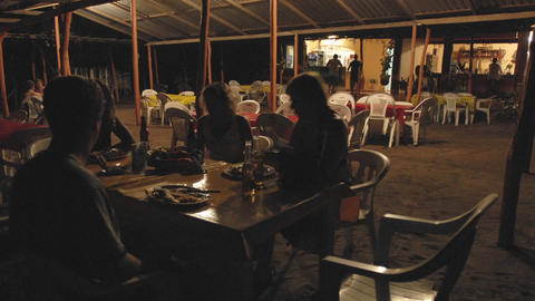 Time lapse of people dining outdoors at La Saladita Beach... Stock Video Footage