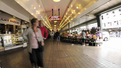 Wide time lapse of people walking at Pike Place Market in downtown Seattle, Washington Footage