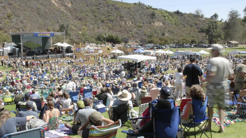 Zoom out time lapse of a crowd at an outdoor concert in Ventura, California Footage