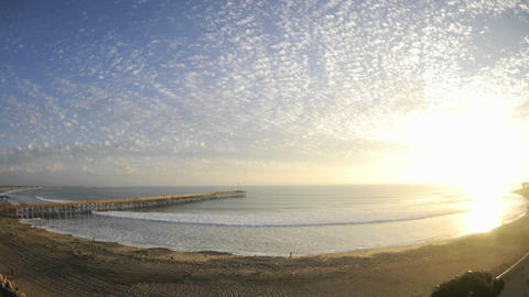 Time lapse of clouds and waves at Ventura Pier in Ventura, California Footage
