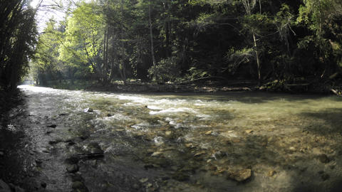 Time lapse of the sun rising over the Big Sur River... Stock Video Footage