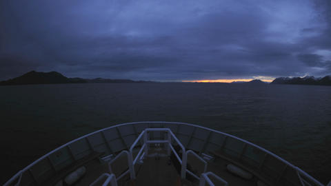 Point of view time lapse of a ship cruising up Chatham Strait at dusk in Southeast Alaska Footage