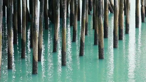 Pier dock posts in ocean P HD 0066 Footage
