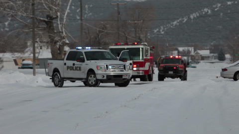 Police fire department respond to emergency winter snow soft focus HD 1665 Footage