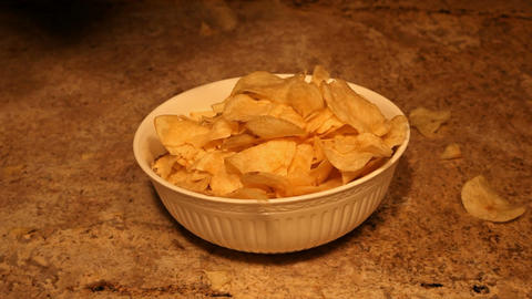 Potato chips dropping into bowl reverse P HD 6351 Live Action