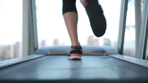 Female feet running fast on treadmill, working hard to succeed and reach goal Footage
