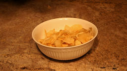 Potato chips dropping into bowl slow motion P HD 6351 Live Action