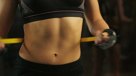 Sportive woman with flat tummy measuring her waist, controls weight loss results Footage