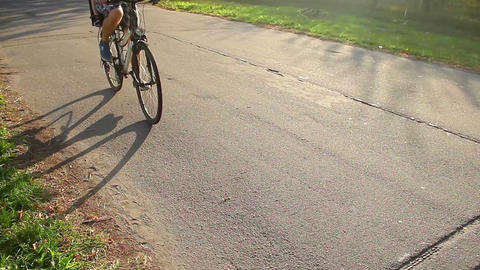 Young man cycling with kid in baby seat, father and child spending time together Footage