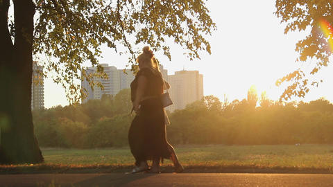Overweight woman strolling in park, health problems due to obesity, overeating Live Action