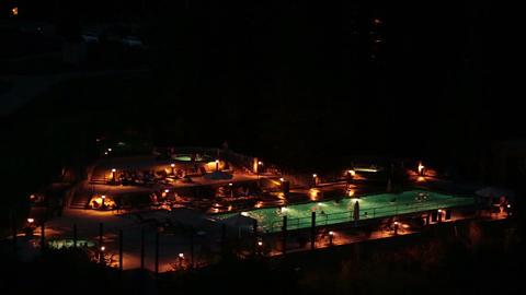 Resort outdoor swimming pool spa night HD 8593 Footage