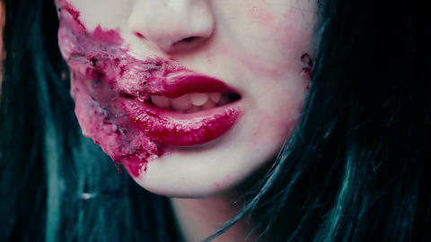 Close-up shot of terrible aggressive monster face with bloody wound near mouth Footage