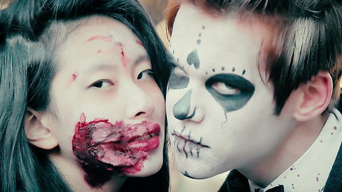 Young man and woman with terrible bloody makeup looking aggressively into camera Footage