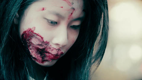 Close up of young female face with ugly bloody wound near mouth, schizophrenic Footage
