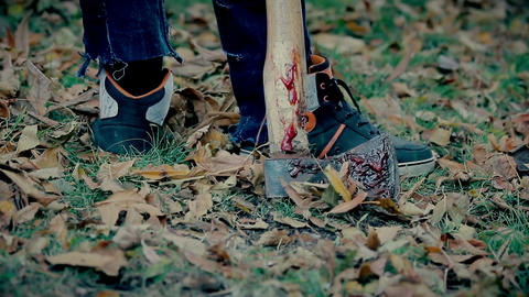 Dangerous psycho murderer drags bloody axe from crime scene, crazy serial killer Footage