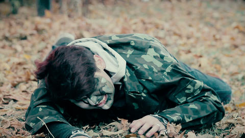 Injured male wearing military uniform crawling, zombie escaping from underworld Footage