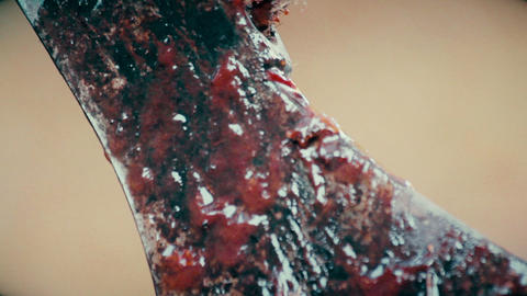 Close-up shot of bloody axe, maniac enjoying terrible look of murder weapon Footage
