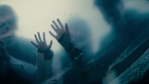 Silhouettes of scary monsters behind transparent film, lost souls in hell Live Action
