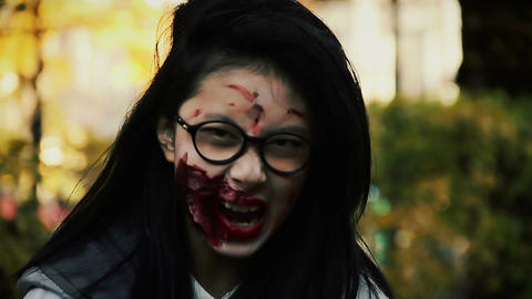 Terrible female zombie looking aggressively into camera, scary bloody vampire Footage