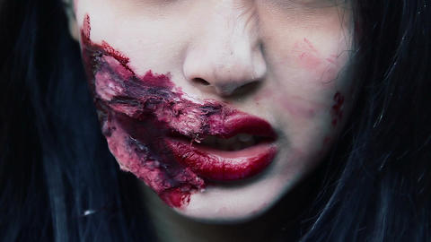 Closeup of terrible vampire face with bloody wound near mouth, dangerous monster Footage