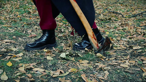 Feet of dangerous insane murderer, maniac dragging bloody axe, searching victim Live Action