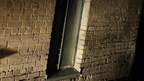 Scary place, grated window in old brick wall, abandoned building, criminal lair Footage