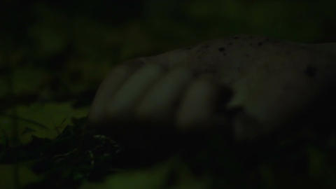 Close-up of person's hand convulsing, maniac strangling victim in dark forest Footage