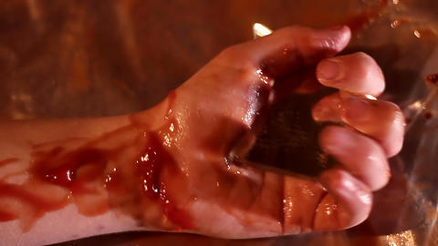 Person dying, human hand convulsing in death agony, corpse in pool of blood ライブ動画