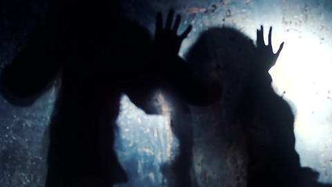 Silhouettes of scary beasts stretching hands towards victim, scary nightmare Footage