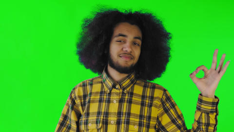 Smiling attractive Afro-American guy showing ok gesture while standing isolated Live Action