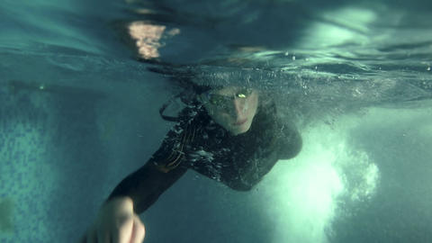 Underwater view professional Triathlete swim in pool, triathlon training action Live Action