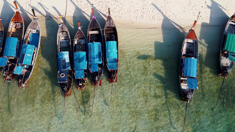 Amazing overhead aerial view of Long Tail Boats on a Thailand Beach Shoreline GIF