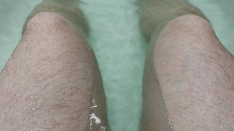 Dirty male feet in the bath Live Action