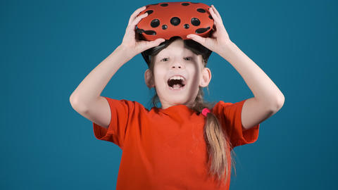 little girl with VR glasses on head surprised by scene Live Action