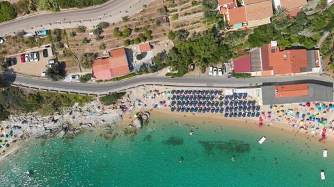 Amazing overhead aerial view of Cavoli Beach, Elba Island in summer season GIF