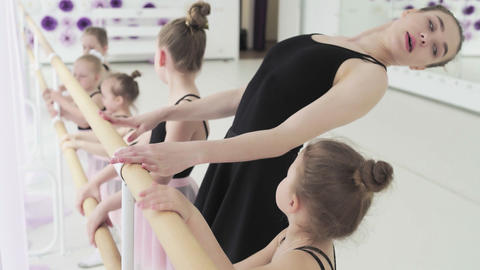 Girl dancer in ballet school learns to dance. Graceful girls in tutus dance the Live Action