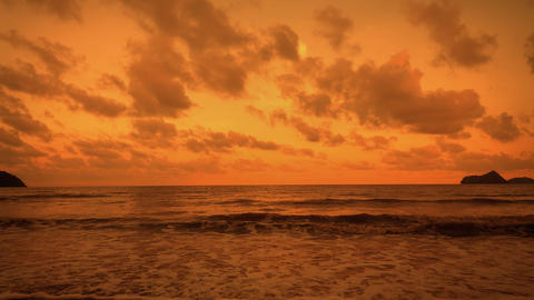 Red sunsets over sea. Red and pink sky with clouds. Summer sunset seascape. 4k Live Action