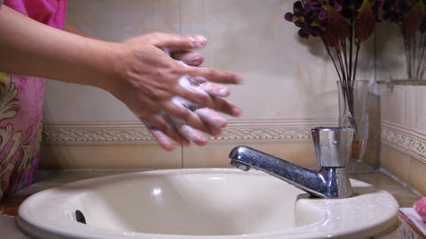 hands with soap warm water using hand sanitizer gel Live Action