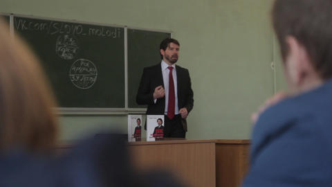 Professor is giving a lecture in the audience to students at university. Kyiv Live Action