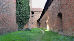 Teutonic Order Castle in Malbork. Passage between castle and the defensive walls Acción en vivo