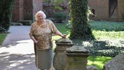 Old woman is admiring walls of teutonic order castle in Malbork Acción en vivo