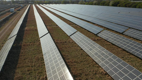 AERIAL: Flight over Solar Panel that produces Green, Environmentally friendly Live Action