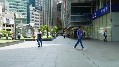 People walking in business district Live Action