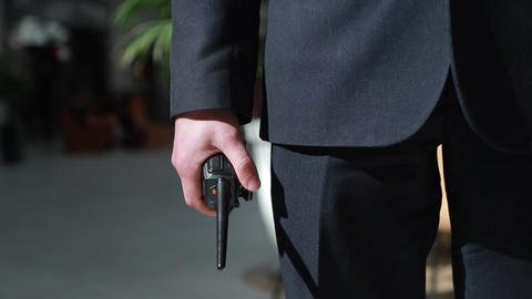 The guard holds a walkie-talkie in his hand. Hand of a security guard holding an Live Action